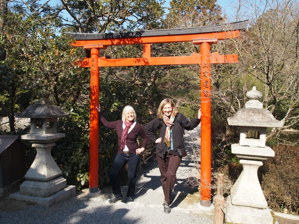 me & holly under a torii gate on a little island at kinkaku-ji