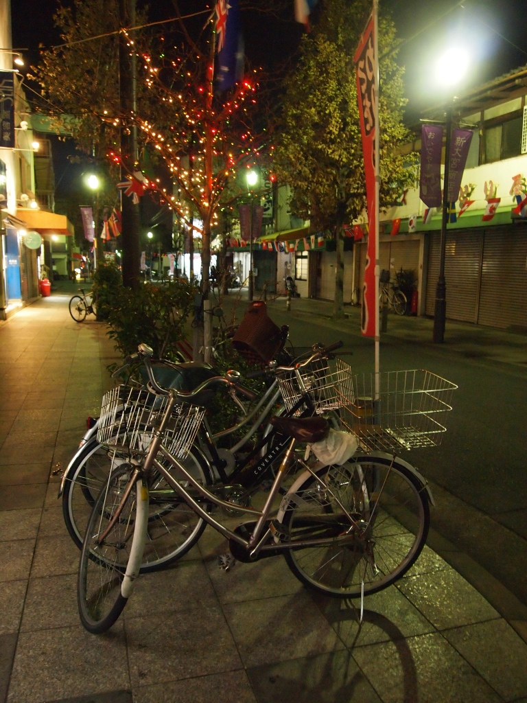 bicycles under a streetlamp on the shopping street