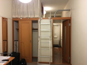 The empty closet and ladder to the sleeping loft