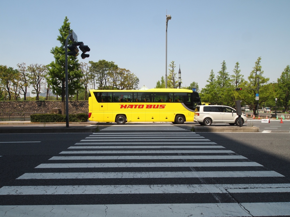 a glowing bus and a crosswalk