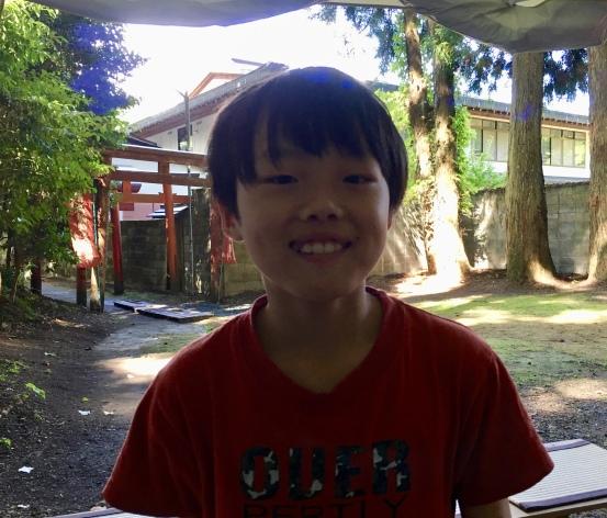 boy at Kiyotaka Inari Shrine